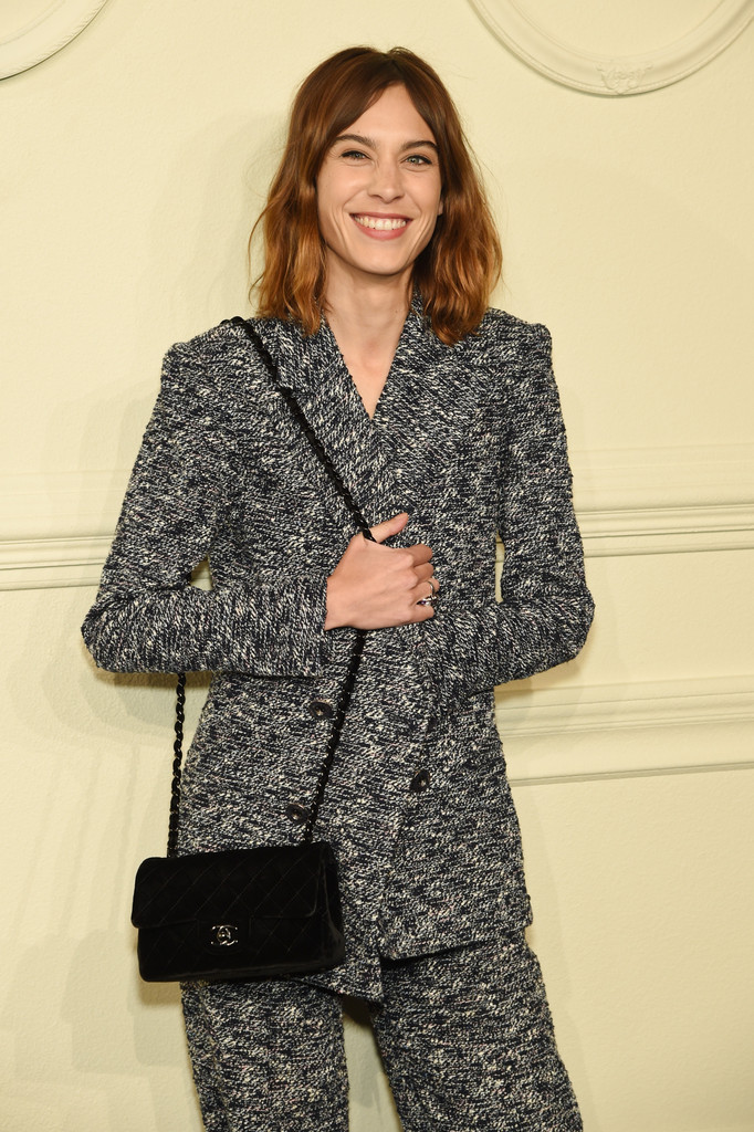 Alexa Chung Teamed A Black Chanel Suede Bag With Gray Pantsuit For The Paris