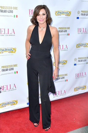LuAnn de Lesseps looked ageless in a plunging black jumpsuit at the Bella New York beauty cover launch.
