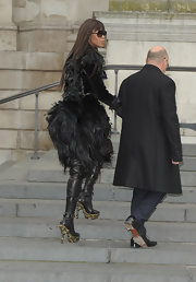 Naomi Campbell showed off an awesome pair of Fall 2010 Mock-Croc platform boots while hitting the Alexander McQueen fashion show.
