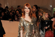 Karen Elson Honors McQueen in a Gold Evening Gown at the Costume Met Gala
