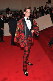 Hamish Bowles complemented his tartan tuxedo with black patent tasseled Miniraja loafers.