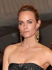 Amber Valletta wore stunning 19th Century amethyst and gold  pendant earrings to the 2011 Met Gala. Her gorgeous jewels worked perfectly with her bare neckline.