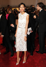 Chanel Iman toughened her sweet lace shift dress with silver studded Pigalili pumps at the 2011 Met Gala.