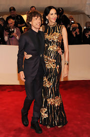 L'Wren Scott was glamorous at the Met Costume Gala in a gold sequined evening gown with a Japanese inspired design.