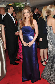 Actress Isla Fisher walked the red carpet at the 2011 Met Gala in a sequined strapless gown.