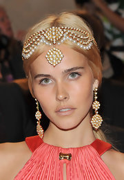 Isabel Lucas brought out the glam for the 2011 Met Gala with a gold earring encrusted with gemstones.