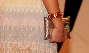 Margherita Missoni paired her woven dress with a bold plated bangle bracelet.