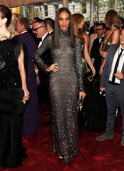 Jourdan Dunn dazzled on the red carpet in a gemstone embellished gown. Sleek center part tresses and ruby lipstick completed her look.