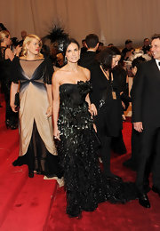 Demi Moore dazzled at the 2011 Met Gala in a strapless feathered black Prabal Gurung dress, which she complemented with a matching feathered Philip Treacy headpiece.