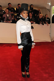 The consistently tuxedo-clad Janelle Monae updated her look in black satin pants, a ruffled neck blouse and corseted cummerbund.