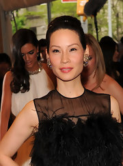 Lucy Liu paired her elegant ballerina bun with chunky gemstone earrings.