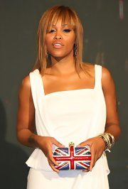 Eve proudly showed off her Union Jack Skull Clutch at the Alexander McQueen store opening.
