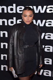 Paloma Elsesser's rhinestone-covered clutch gave her dark outfit a dose of sparkle at the Alexander Wang Fall 2019 show.