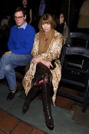 Anna Wintour teamed brown knee-high boots with a leopard-print coat for the Alexander Wang fashion show.