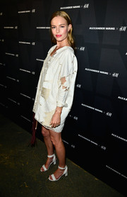 Kate Bosworth donned a loose white mesh-panel cardigan by H&M for the Alexander Wang x H&M Coachella party.