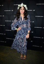 Emmy Rossum kept it easy-breezy in a sheer print dress during the Alexander Wang x H&M Coachella party.