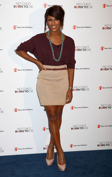 Singer Alexandra Burke poses during a photocall for the Save the Children