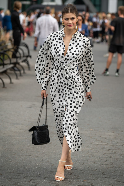 Alexandra Daddario Chain Strap Bag [street fashion,clothing,white,fashion,black-and-white,polka dot,pattern,design,footwear,outerwear,sandals,alexandra daddario,polka dot dress,shoulder bag,new york city,garden of the battery,street style,new york fashion week]