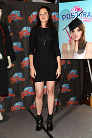 Alexis wore the body-hugging jersey Jacob Dress with lace up booties.