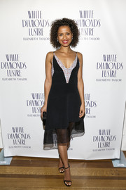 Gugu Mbatha-Raw complemented her dress with a pair of simple slim-strap sandals.