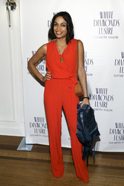 Rosario Dawson was casual-chic in a red wrap-bodice jumpsuit during Alfre Woodard's Oscar's Sistahs Soiree.