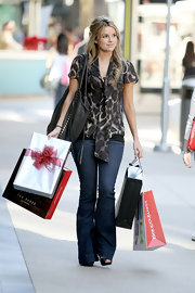 Ali wore a large leopard print tie neck blouse for shopping in Santa Monica.