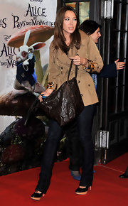 Looking a little confused Laura Smet walked the red carpet toting around a brown leather tote. Her leopard embellished tan trench was a nice complement to her tote.