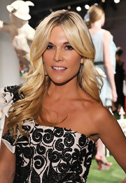 Tinsley Mortimer attended the Alice + Olivia Spring 2012 fashion show with her long hair in flowing waves. To try her look at home, use a large-barreled curling iron, curl two-inch sections away from the face and tousle hair to finish.