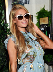 A pair of cateye shades with a contrast top bar finished off Paris Hilton's look.