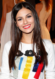 Victoria Justice made a slight variation to her signature long center-parted style by wearing partial braids.
