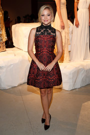 Olivia Holt donned an Alice + Olivia jacquard cocktail dress with a lace yoke for the brand's presentation.