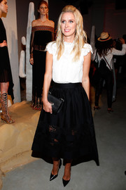 Nicky Hilton attended the Alice + Olivia presentation looking demure in a white blouse with a lacy yoke and cap sleeves.