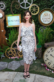 Anne Hathaway paired her dress with classic black ankle-strap sandals by Paul Andrew.