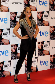 Alicia Keys paired her tunic top and leggings with studded strappy sandals.