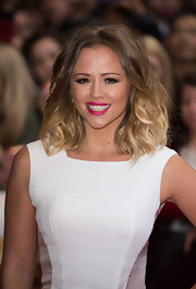 Kimberley Walsh injected some color into her look with a swipe of bright pink lipstick at the 'All Stars' premiere.