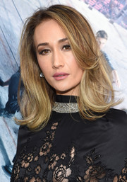 Maggie Q debuted a shorter, lighter hairstyle, done in a bouncy flip, at the New York premiere of 'Allegiant.'