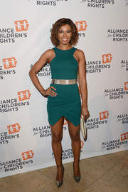 Toks Olagundoye was sexy and modern in a green geometric-hem mini during the Alliance for Children's Rights dinner.