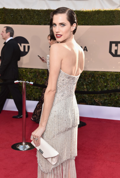Allison Williams Envelope Clutch [red carpet,dress,clothing,carpet,shoulder,flooring,strapless dress,hairstyle,fashion,premiere,arrivals,allison williams,screen actors guild awards,los angeles,california,the shrine auditorium]