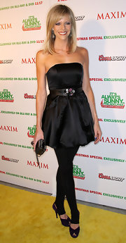 Kaitlin wears a little black strapless dress with a bubble hem and a jeweled belt.