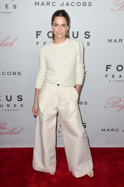 Amanda Peet Wide Leg Pants [the beguiled,white,red carpet,clothing,shoulder,carpet,fashion,joint,flooring,premiere,fashion design,amanda peet,new york city,the metrograph,new york premiere]