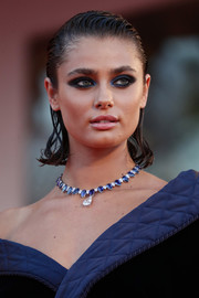 Taylor Hill opted for a wet-look 'do when she attended the Venice Film Festival screening of 'Amants.'