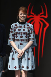 Emma Stone cut a regal figure at the 'Amazing Spider-Man 2' Berlin photocall in a caped blue Erdem dress with intricate red beading.