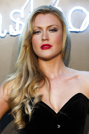 Camilla Kerslake wore her long curls swept to the side during the Amazon Fashion Photography Studio launch.