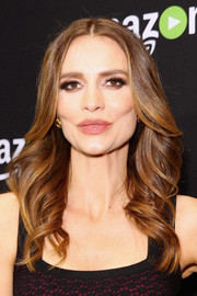 Saffron Burrows attended Amazon's Golden Globes celebration wearing this feathered flip.