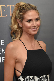 Heidi Klum complemented her 'do with a chic diamond ear cuff.