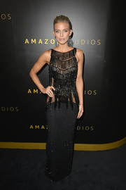 AnnaLynne McCord looked provocative in a fringed, sheer-bodice column dress at the Amazon Studios Golden Globes after-party.