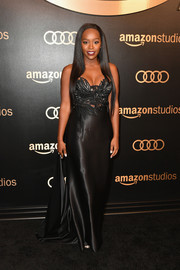 Aja Naomi King looked va-va-voom in a black fishtail gown with a fitted, embroidered bodice at the Amazon Studios Golden Globes celebration.