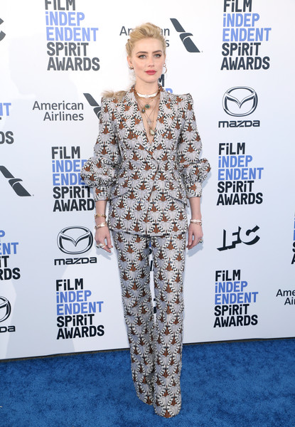 Amber Heard Pantsuit [clothing,red carpet,carpet,hairstyle,suit,fashion,pantsuit,premiere,fashion design,flooring,arrivals,amber heard,film independent spirit awards,santa monica,california,jennifer lopez,35th independent spirit awards,santa monica,american music awards of 2018,indie film,academy awards,film awards seasons,entertainment,stock photography,independent spirit awards]