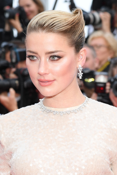 Amber Heard French Twist [les miserables,hair,hairstyle,eyebrow,beauty,blond,lip,skin,chin,fashion,eye,amber heard,screening,cannes,france,red carpet,the 72nd annual cannes film festival]