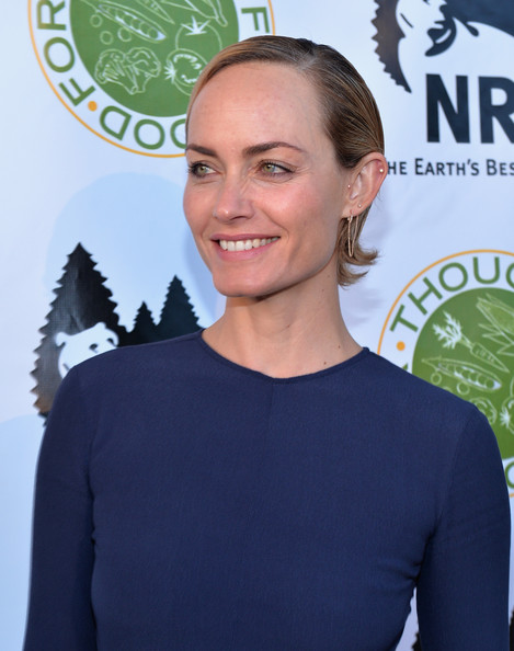 Amber Valletta Short Side Part [hair,hairstyle,premiere,smile,electric blue,neck,long hair,brown hair,black hair,style,natural resources defense council,thought for food,ndrc food for thought benefit,eating,santa monica,california,amber valletta]